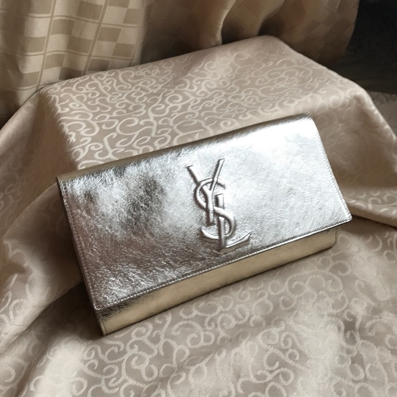 c33577775e1a AUTH YSL BELLE DE JOUR GOLD CLUTCH PURSE LUXURY.  M 5a5e48293afbbdc4a361570b. Other Bags you may like. Yves Saint Laurent ...